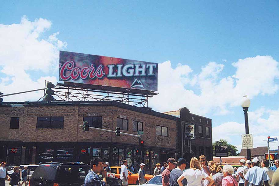 Southwest corner of Clark St. and Addison St.This billboard is located in Wrigleyville accross the street from Wrigley Field, home of the Chicago Cubs Major League Baseball Team. This popular neighborhood is densely populated with very upscale young urban professionals. Entertainment in the area also includes numerous restaurants, clubs and bars.